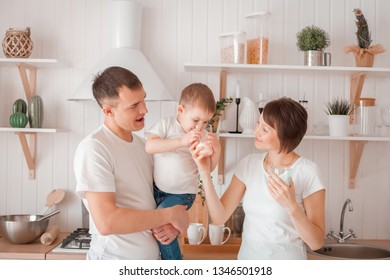 Happy family are drinking milk in the kitchen