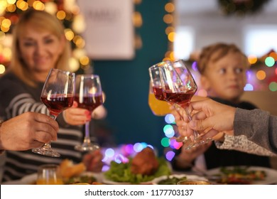 Happy family drinking wine during Christmas dinner at home