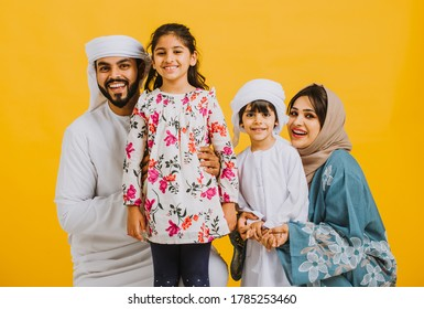 Happy family in Dubai. parents and children with traditional emirati clothes taking portraits