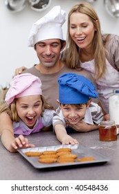Happy family eating cookies after baking in the kitchen