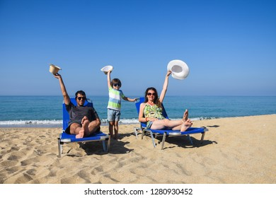 Happy family enjoy  in deck chairs on the beach during summer vacations