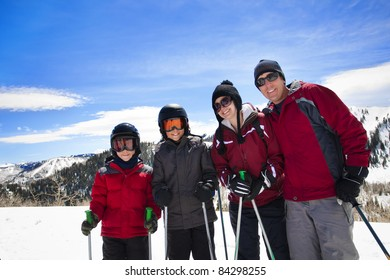 Happy Family Enjoying a day Skiing together