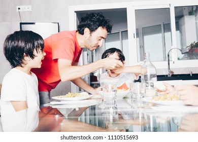 happy family enjoying dinner at the kitchen