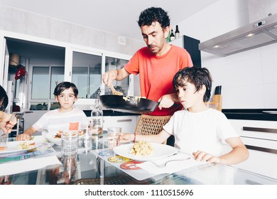 happy family enjoying dinner at the kitchen