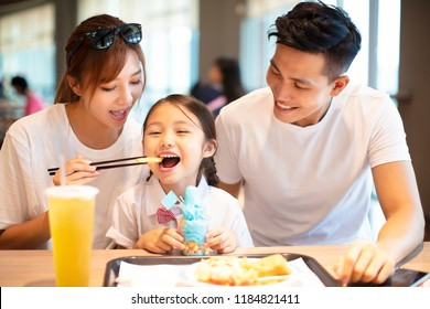 Happy family  enjoying dinner in restaurant.