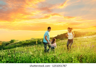 happy family enjoying the life together outdoors