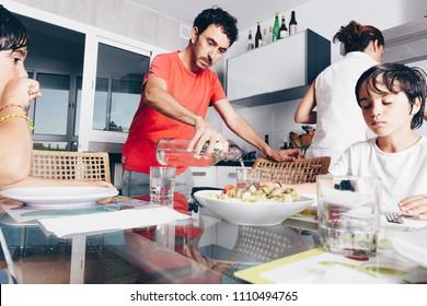 happy family enjoying meal at kitchen
