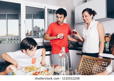 happy family enjoying meal at kitchen