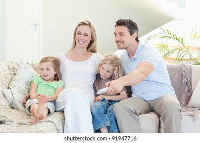 Happy family enjoying a movie together