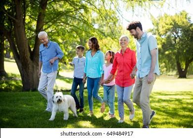 Happy family enjoying in park on a sunny day