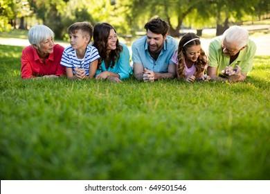 Happy family enjoying in park on sunny a day