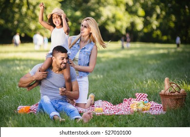 Happy family enjoying picnic in nature