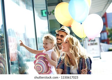 Happy family is enjoying shopping early in the morning.