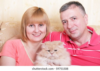 A happy family enjoying their free time at home with fluffy cat