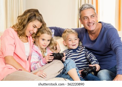Happy family enjoying video games together at home