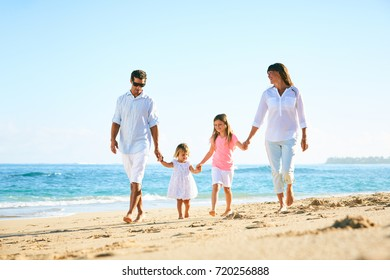 Happy family enjoying walk on the beach