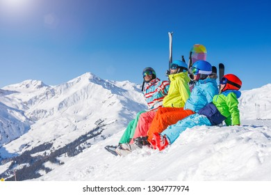 Happy family - enjoying winter vacations in mountains . Ski, Sun, Snow and fun.