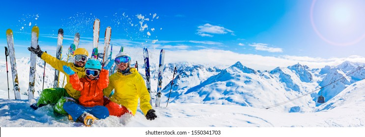 Happy family enjoying winter vacations in mountains, Val Thorens, 3 Valleys, France. Playing with snow and sun in high mountains. Winter holidays.