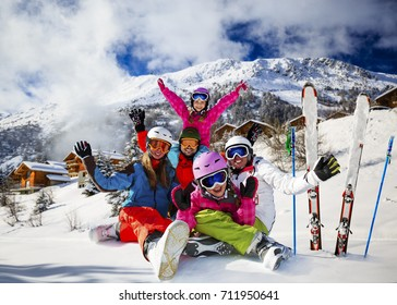 Happy family enjoying winter vacations in mountains . Ski, Sun, Snow and fun. Composite photo, four person only.