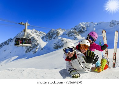 Happy family enjoying winter vacations in mountains. Playing with snow, Sun in high mountains. Winter holidays.