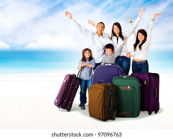 Happy family excited about a trip with bags and arms up