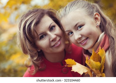 Happy family in fall park