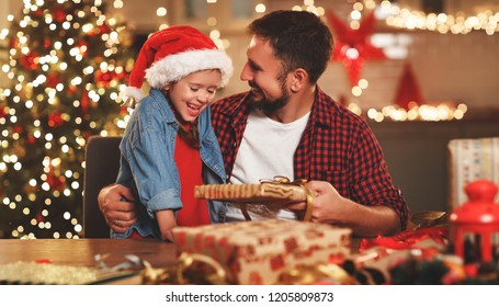 a happy family father and child pack Christmas gifts