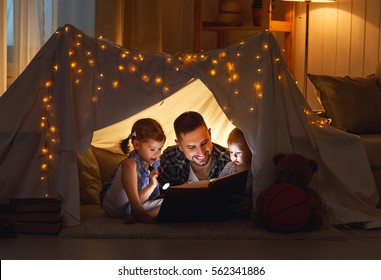 Family reading images stock photos vectors shutterstock happy family father and children reading a book with a flashlight in a tent at home sciox Gallery