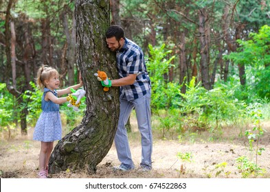 A happy family, father and daughter are playing in nature, a copy of the free space. Background Father's Day.