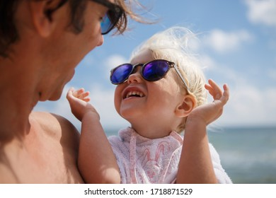 happy family father and daughter relax and play by the sea on the beach in summer