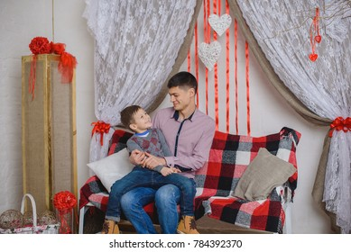 Happy family. Father and son in romantic room with decoration for st. Valentine's day
