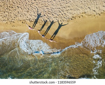 Happy family of four having fun in the summer vacation. Aerial drone bird's eye view photo.