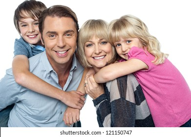 Happy family of four members posing together isolated on white background