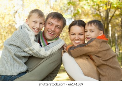 happy family of four on the nature