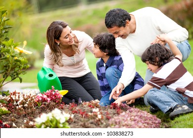 Happy family gardening together and taking care of nature