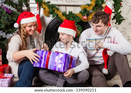 Happy Family Gifts Sitting Near Christmas Stock Photo (Edit Now ...