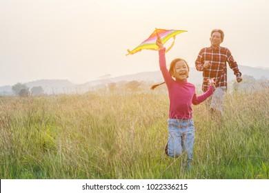 happy family .Girl runs kite in summer