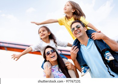 Happy family going on holidays and traveling by airplane