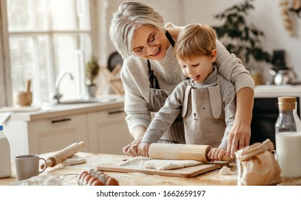 happy family grandmother and grandson child  cook in the kitchen, knead dough and bake cookies - Shutterstock ID 1662659197