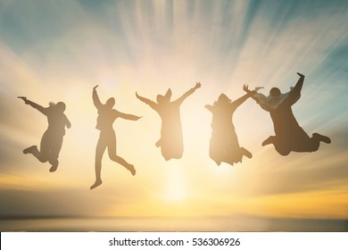 Happy family group feel proud and celebrate good life to great wellness support team concept for people financial freedom, friends day. New generation fly jump on summer landscape sunset background.