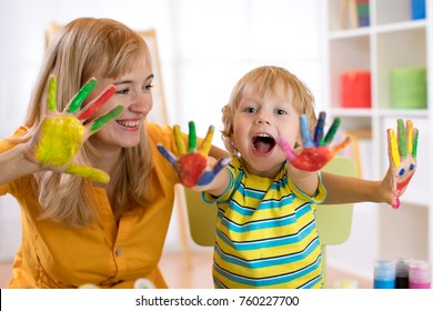 Happy family have a fun pastime with colorful hands painting at home