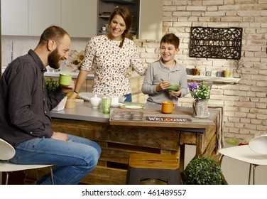Happy family having breakfast in the morning at home.