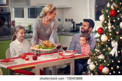 Happy family having Christmas dinner together