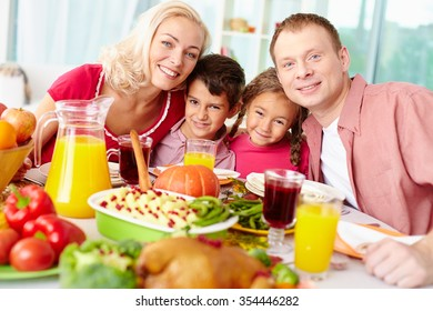 Happy family having dinner together at home