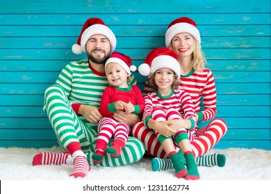Happy family having fun at Christmas time. Father, mother and children at home. Xmas holiday concept