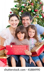Happy family having fun with Christmas presents