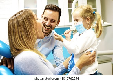 Happy family is having fun in dental office.