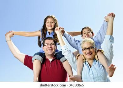 Happy family having fun giving shoulder rides