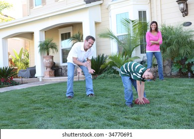 A happy family having fun at  home playing football sports