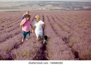 happy family having fun in lavender field